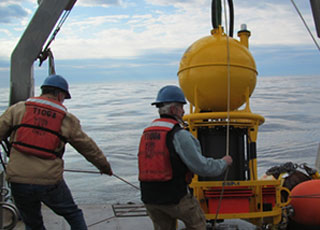 Scientists deploy an Environmental Sample Processor to detect toxic Alexandrium blooms in the Gulf of Maine.