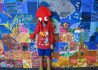 Photo of a child in a squid-shaped hat