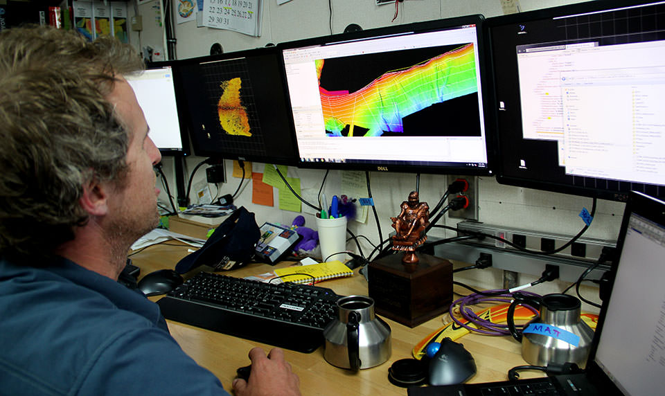 NOAA hydrograher Mike Stecher converts sonar data into imagery.