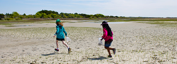 kids running at North Carolina National Estuarine Research Reserve