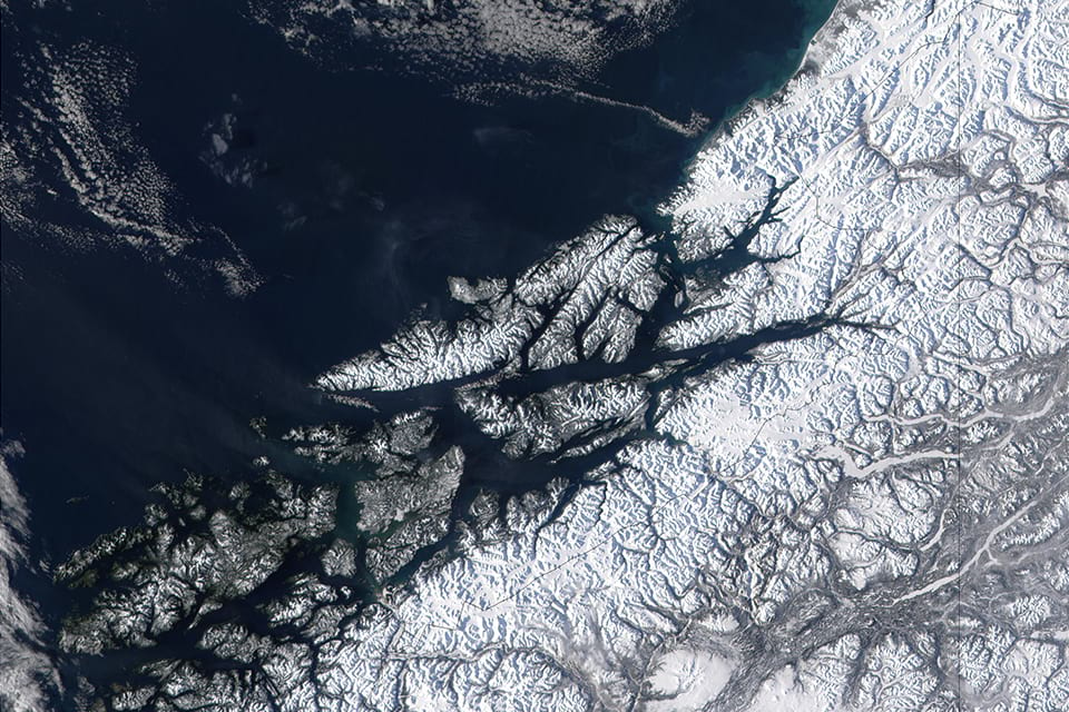 West of British Columbia, Canada, and south of the Yukon Territory, the southeastern coastline of Alaska trails off into the islands of the Alexander Archipelago. Photo Credit: NASA