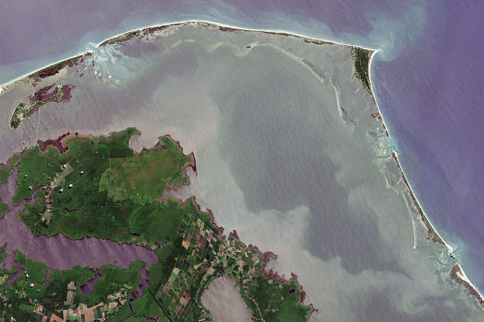 Satellite image of Cape Hatteras National Seashore on the Outer Banks of North Carolina. Credit: NASA's Earth Observatory.