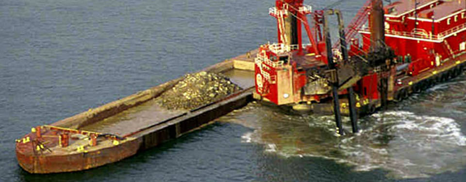 As sand and silt washes downstream, sedimentation gradually fill channels and harbors. This material must be periodically removed by dredging. (Image credit: U.S. Environmental Protection Agency)