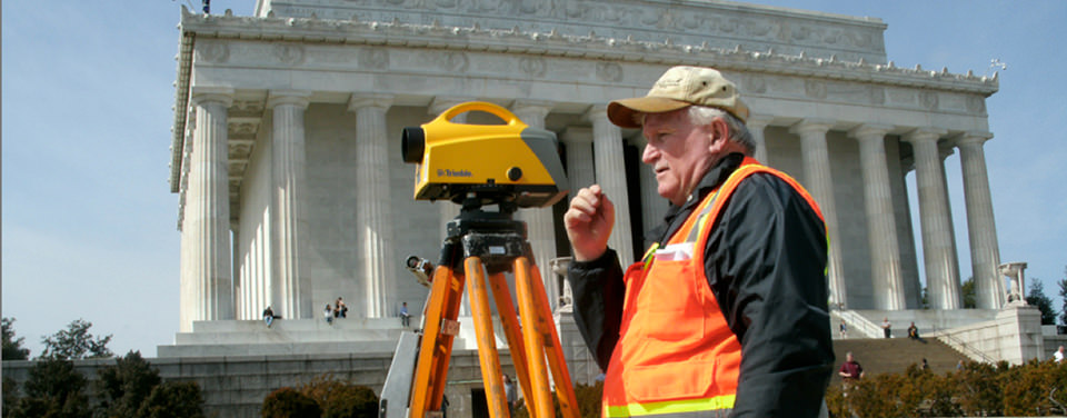 NGS surveyor measures the difference in elevation between two points in front of the Lincoln Memorial in Washington, D.C.