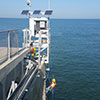 Staff install the final components on the NOAA water level station on the Chesapeake Bay Bridge Tunnel