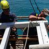 A NOAA field crew prepares a current meter mooring for deployment in Puget Sound, Washington.<br />
