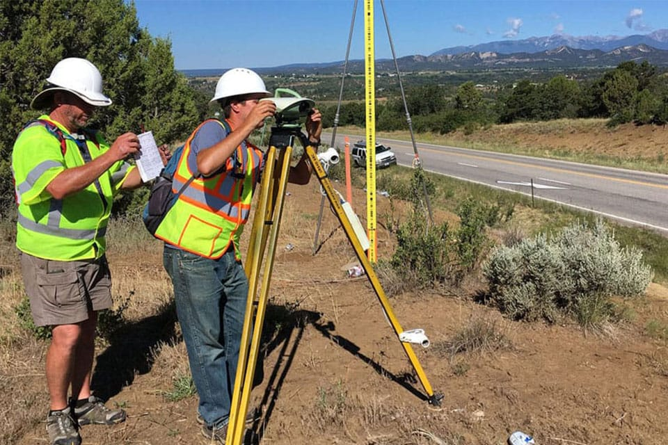 NOAA surveyors Charles Geoghegan and Benjamin Erickson conducting a geodetic surveying project in Colorado in the summer of 2017.