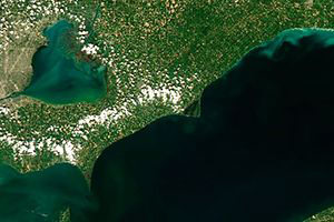 Satellite image of Lake Erie showing a mild harmful algal blom in the southwestern portion of the lake