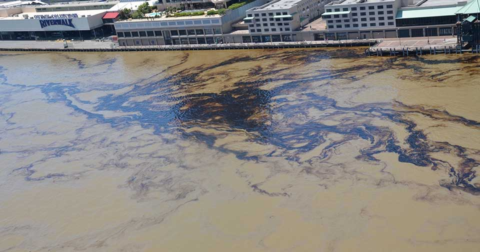 Oil along the New Orleans River Walk following a spill that happened Thursday, April 12, 2018. Image credit: U.S. Coast Guard.