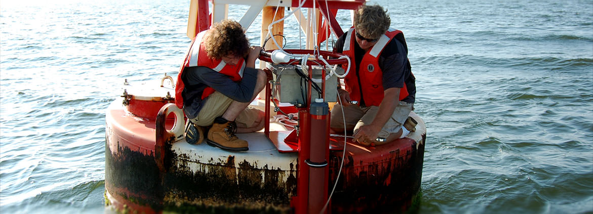 installation of a new acoustic sensor on a buoy in Chesapeake Bay