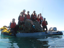 Marine debris is hauled to the NOAA Ship Sette on an inflatable-hull raft.