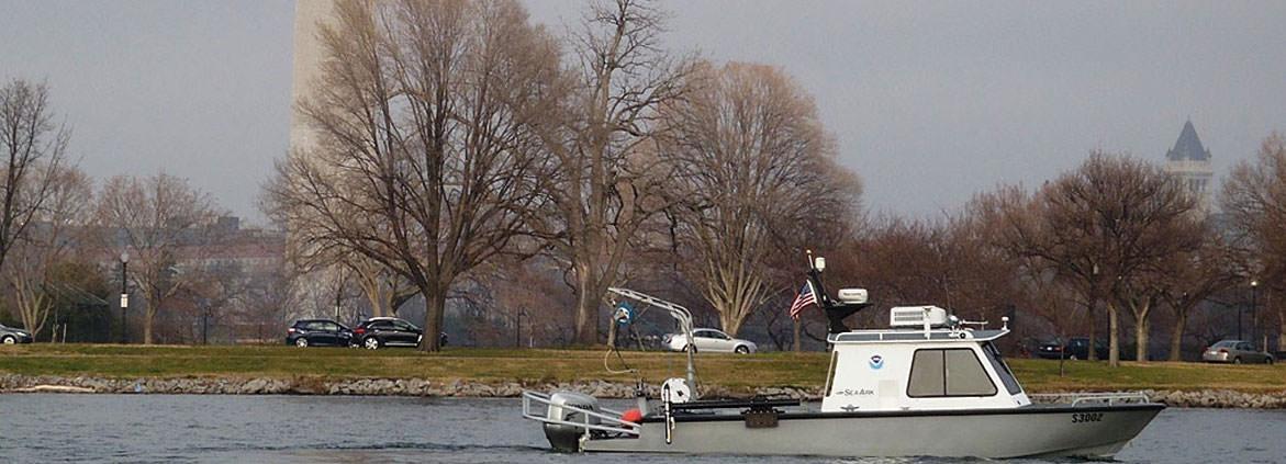 a NRT vessel surveys the Potomac River Tidal Basin near the Washington Monument