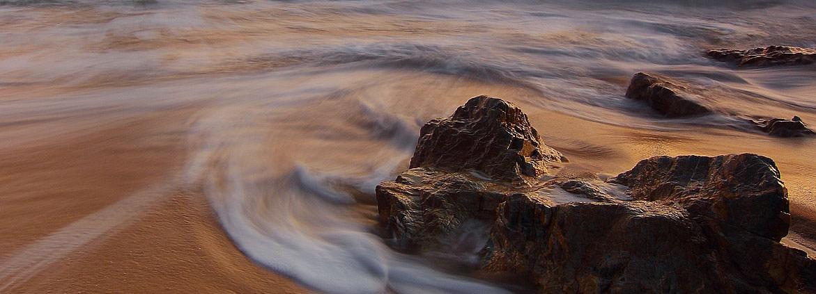 rocky beach with tide