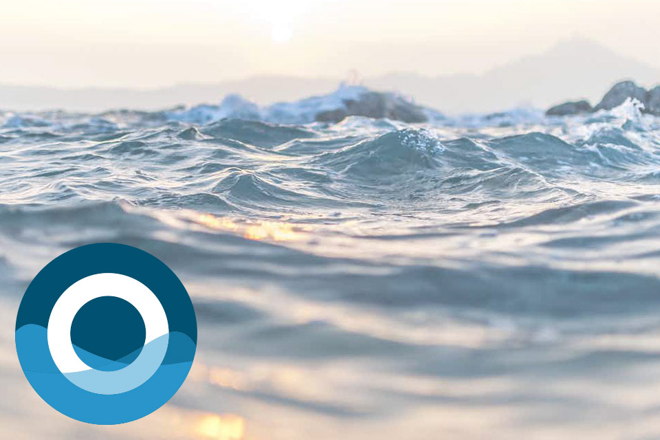 an image of ocean water with the OceanReports logo