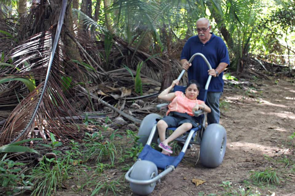 a disabled person enjoying a trail within the Punta Tuna Wetland Natural Reserve in Puerto Rico.