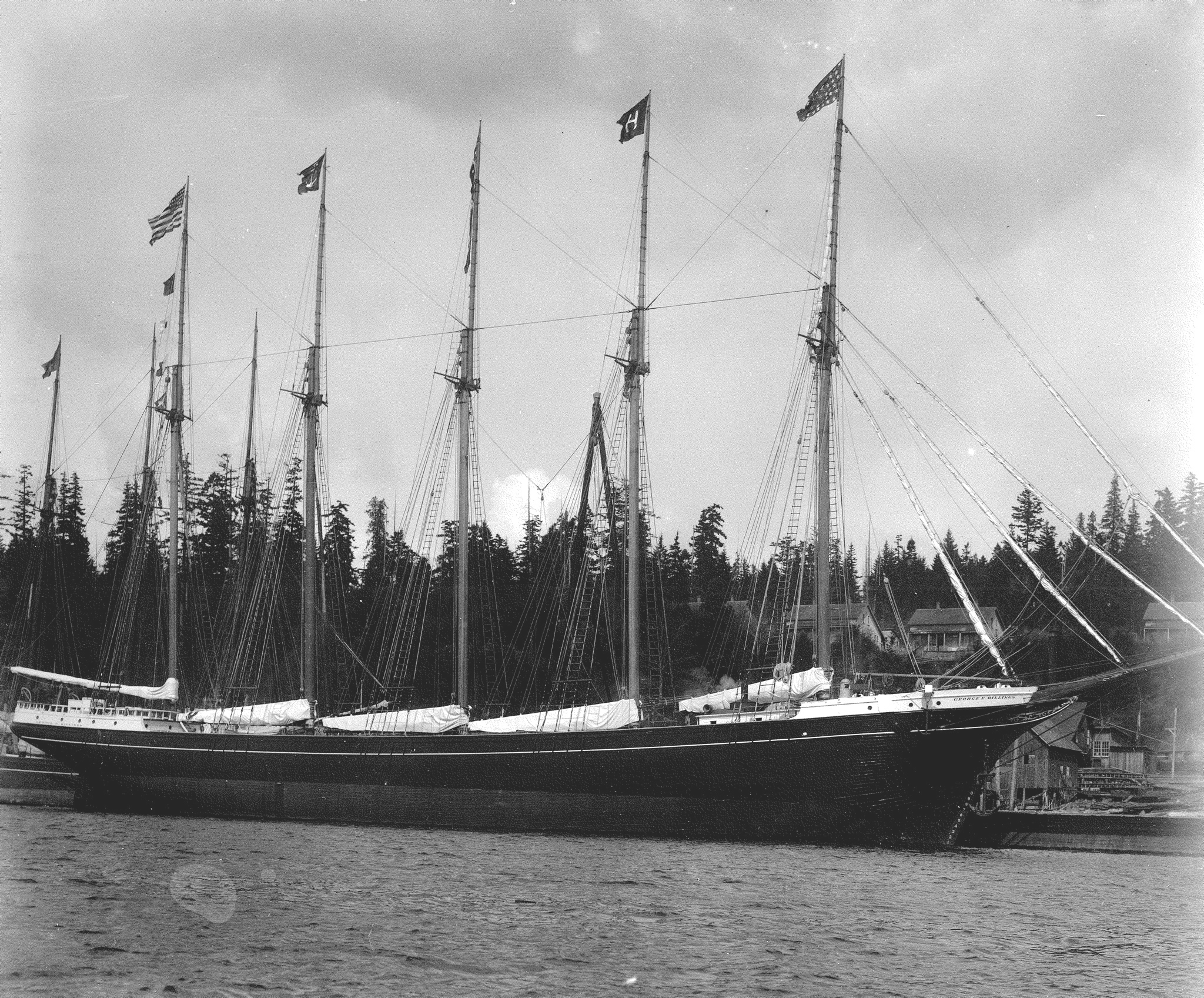 Five-masted lumber schooner George E. Billings shortly after launching flying the Hall Bros. house flag from the mast. The Hall Bros. built the 224-foot wooden vessel at Port Blakely, Washington for their own account in 1903. (Photo courtesy of San Francisco Maritime Historic Park: f1.12028)