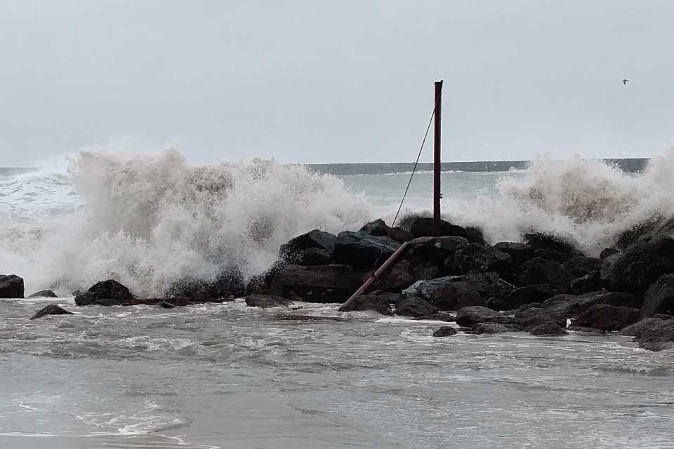 A sneaker wave crashes on rocks on the Oregon Coast.