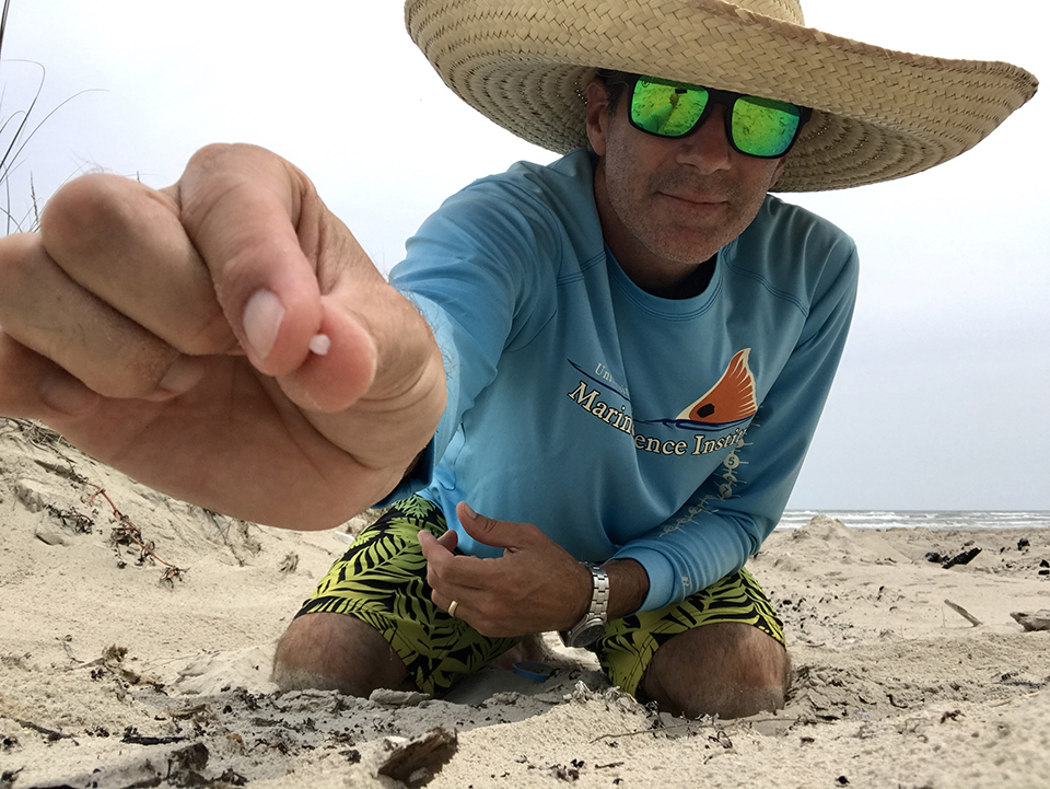 Jace Tunnell, Director of the Mission Aransas National Estuarine Research Reserve, holds a nurdle in his hand. Photo Credit: Jace Tunnell.