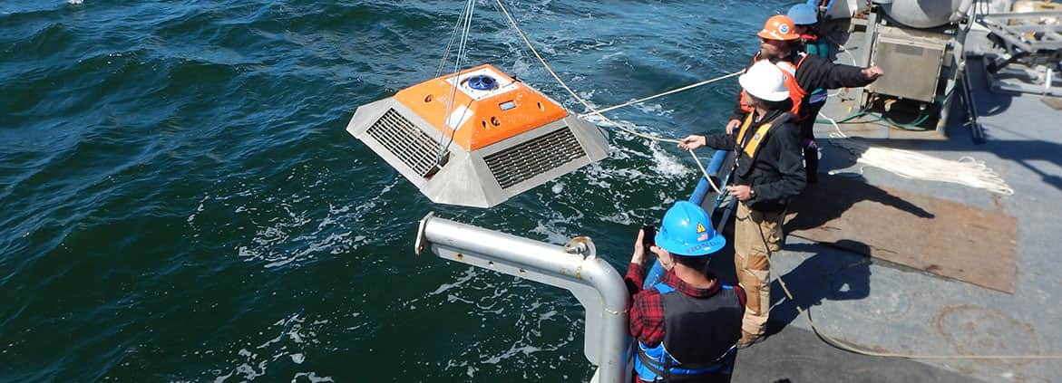 a NOAA team deploys a current meter to survey along the bottom of Puget Sound.