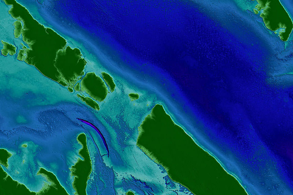A digital elevation model of the Florida Keys area from a topobathy lidar system. Green represents higher elevations and dark blue/purple represents lower elevations.