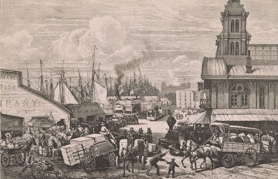 rint shows congestion of horse-drawn carts and wagons overburdened with merchandise on Dock Street, also handcarts, teamsters and longshoremen, and railroad locomotives and cars for hauling goods from ships to markets, includes many wholesale buildings and a transportation terminal, and the masts of many ships docked along the waterfront.