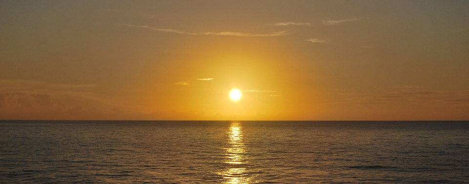 Sunset over the Caribbean Sea. Credit: Julie Malick